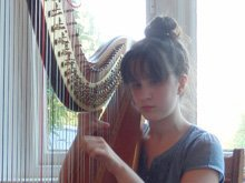 Zoe Playing the Harp