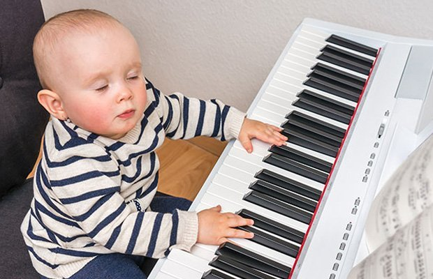 Small baby at a piano